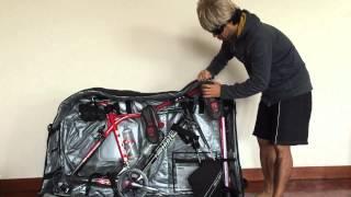 evoc bike travel bag review tips to protect wheels and handlebar