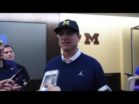 Michigan football coach Jim Harbaugh describes hockey coach Red Berenson as a