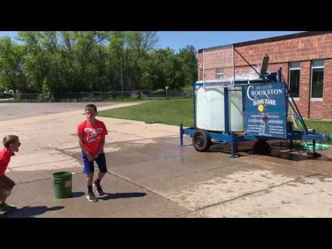 Highland School students dunk the Principal   KROX/KROXAM.com