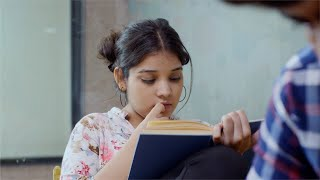 Closeup shot of an Indian girl reading a book very carefully - education concept