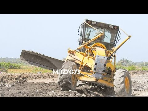 Motor Grader Working Grading Dirt And Rocks