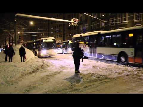 Tow truck helping buses on slippery street (Hämeentie, Helsinki, Finland)