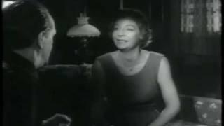 Dansk Filmhistorie - En fremmed banker på (1959)