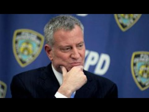 NYC mayor skips NYPD swearing-in ceremony to join protest