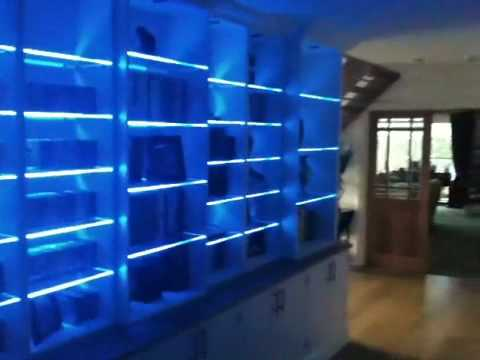 Colour Changing Led Lights On A Bookcase With Glass