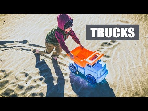 Toy Construction Trucks in the Sand at Ocean Beach San Francisco with Wilce