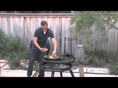 Justin Jones cooks breakfast and cleans fire pit.