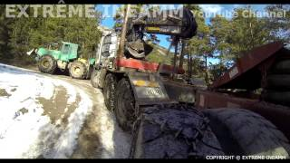GRUMIER MONTÉE SUR PISTE DE GLACE , LOGGING TRUCK ICE ROAD IN MOUTAINS