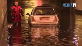 Wateroverlast na hevige regenval Rotterdam Schiedam en omgeving