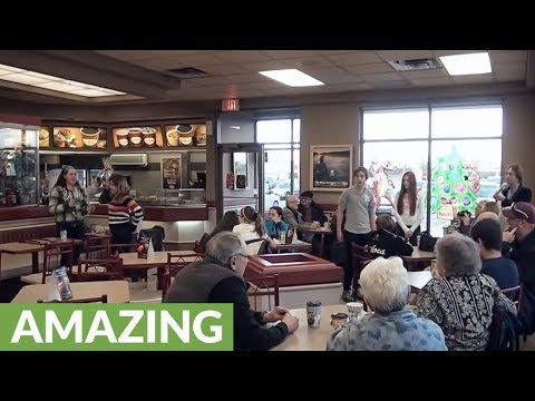 Talented young musicians pull off Christmas flash mob at coffee shop