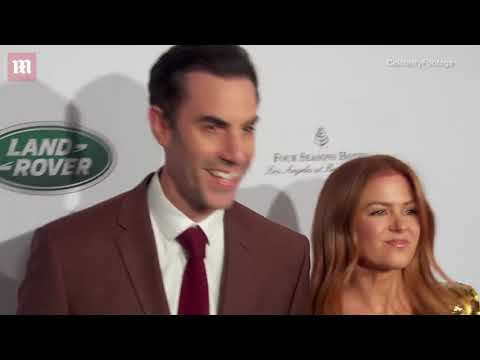 Isla Fisher Slays The Red Carpet In Low-cut Gown At BAFTA Party