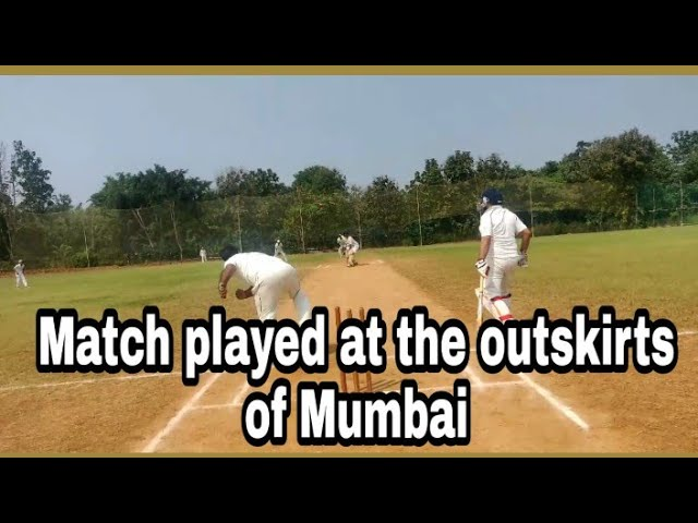 Umpire View of cricket match played on a cricket ground in dombivali