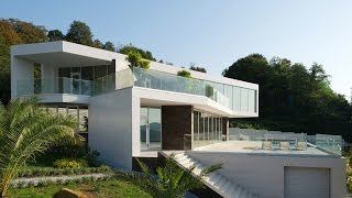 видео Проекты и строительство домов в стиле модерн