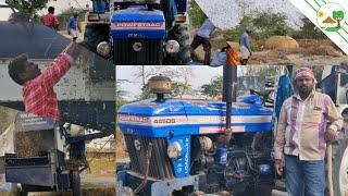Valasumani Multicrop thresher for blackguard threshing with Powertrac Tractor