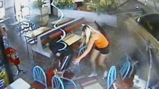 Taco Bell crash: The moment a mini-van smashes into an Ohio restaurant narrowly missing customers