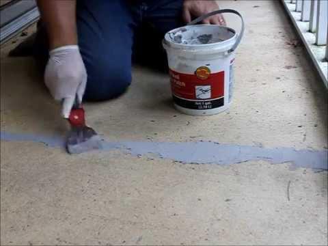patching a cracks on a concrete porch