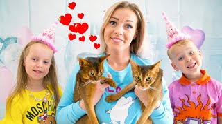 Gaby and Alex celebrating their kittens birthday and give them presents
