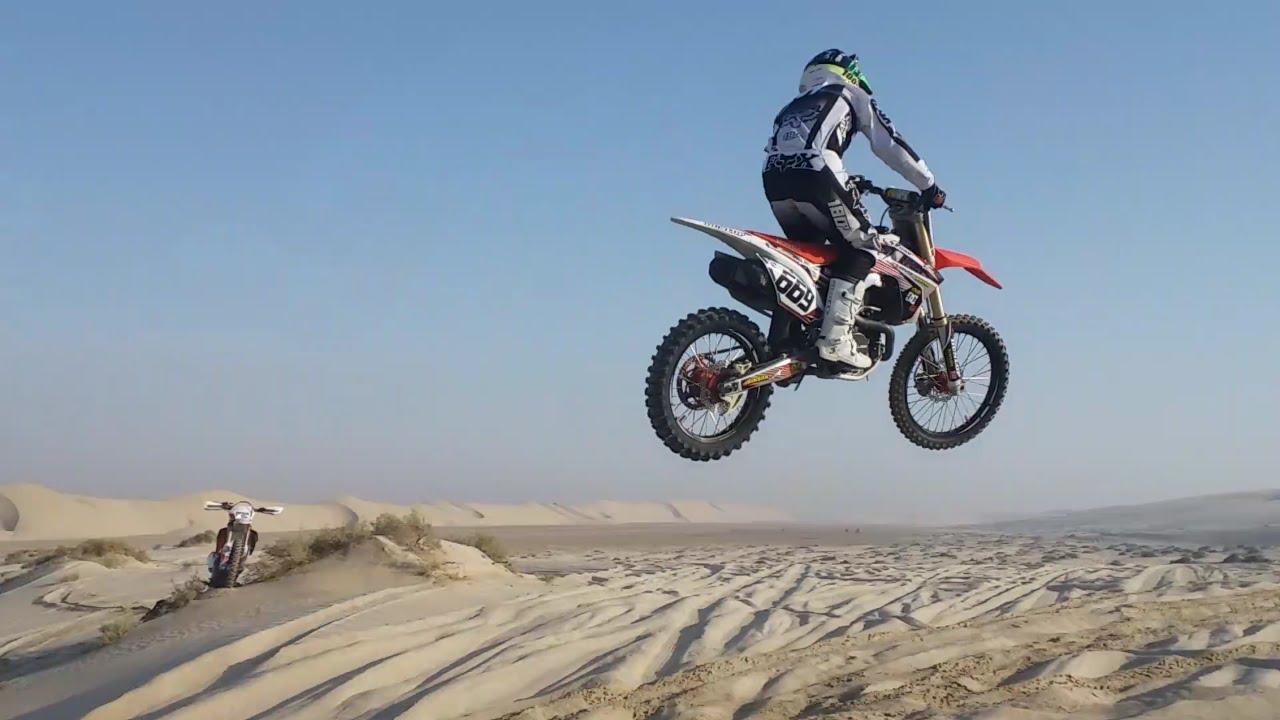 Dirt Bike Desert Riding Dune Jumps Wheelies And Camel Grass