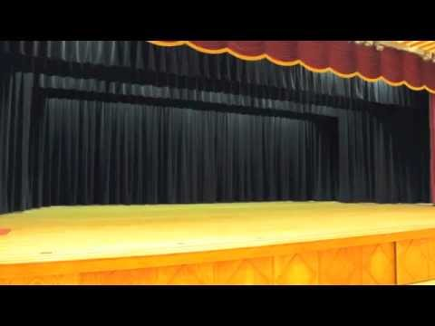 Auditorium stage curtains and motorized rigging. Auditorium motorized theater drapes.