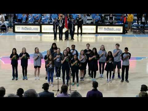 Peak Charter Academy performs the National Anthem for UNC basketball