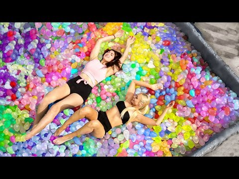 10,000 Water Balloons In A Ball Pit!