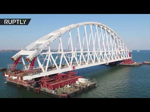 Russia installs Crimea bridge railway arch in 'unique operation' (DRONE FOOTAGE)