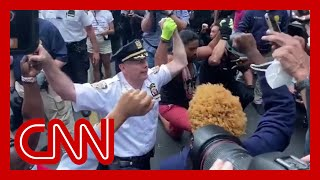 NYPD chief takes a knee with George Floyd protesters
