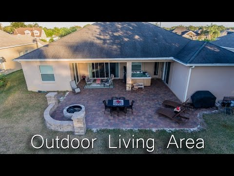 Outdoor Living Area Renovation with Brick Pavers, Fire Pit and 7 Person Hot Tub