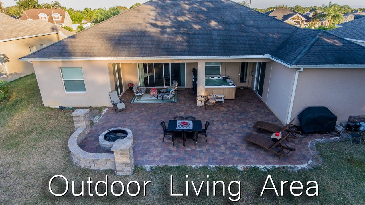 Outdoor Living Area Renovation With Brick Pavers Fire Pit And 7 Person Hot Tub