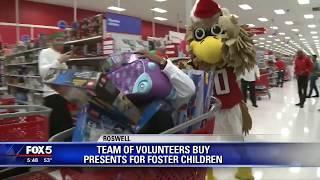 Team of volunteers buy presents for foster children
