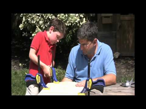 Father and 6 year old son assemble the DIY Bat House Kit