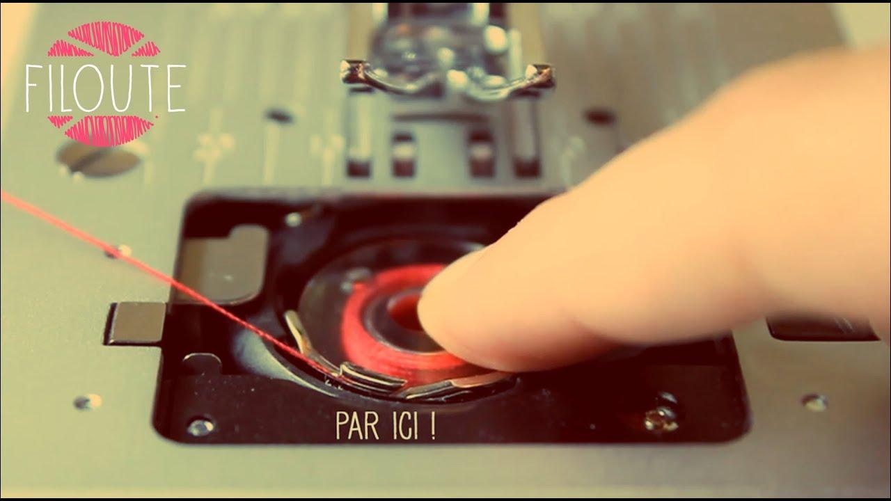 Machine coudre installation de la canette youtube for Machine a coudre singer