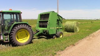 Baling Hay With A JD 535 Round Baler