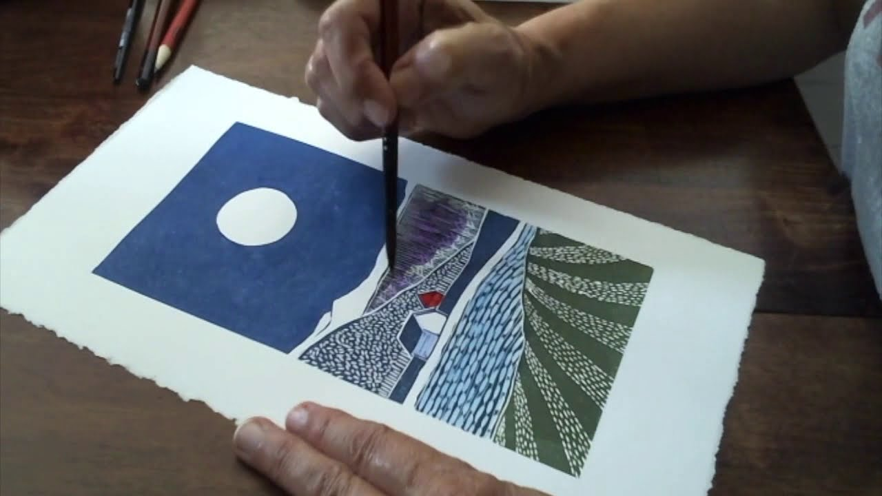 "Adding Watercolor to the Lino Print ""Lake Front Cabin""."