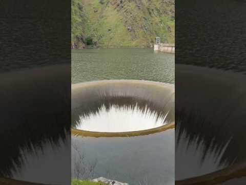 Dam overflow drain