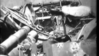 7.2 inch rockets tested on beach of Iwo Jima; men fire 75mm pack howitzer