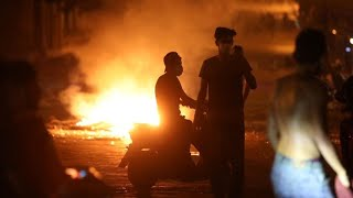 Lebanese police tear gas anti-government protesters in wake of devastating blast