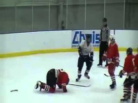 Hockey Player Breaks Stick On Opponent