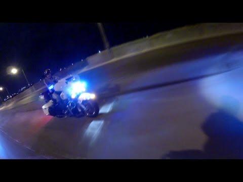 Biker fleeing police wheelies into oncoming traffic