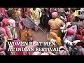 Women hit men with sticks at traditional Indian festival celebration