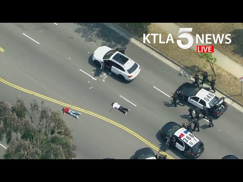 Shooting suspect in custody after police pursuit in Mid-Wilshire area of Los Angeles