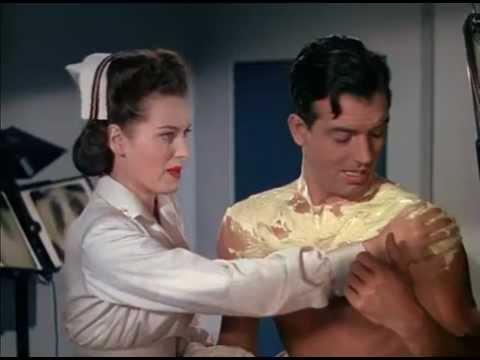 """Maureen O'Hara and John Payne in """"To the Shores of Tripolis"""" (1942)"""