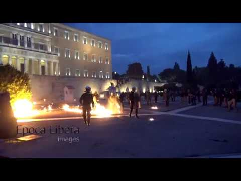 Molotov cocktails at the Greek parliament as lawmakers vote new austerity -4K