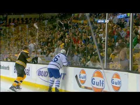 Milan Lucic hits Mike Van Ryn through the glass [HD]