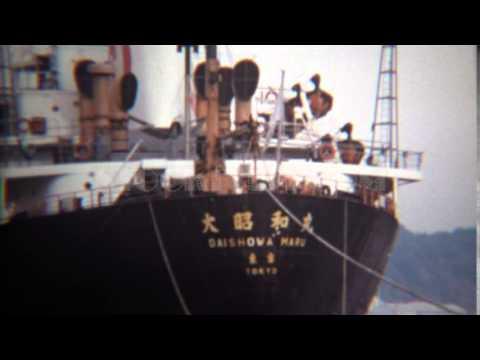 1971: Daishowa Maru Tokyo industrial cargo ship zoom out. ASTORIA, OREGON