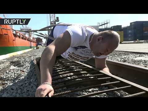 RAW: Russian strongman attempts to set a new record by towing 10,500-tonne ship