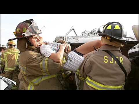 Firefighters - Rescue - Woman - Car Crash - Accident - Stock Footage