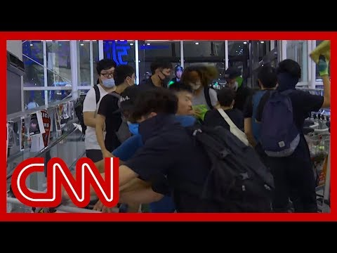 Chaos erupts at Hong Kong airport as riot police take on protesters