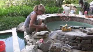 Master Stone Mason Builds Natural Stone Spillway into Swimming Pool