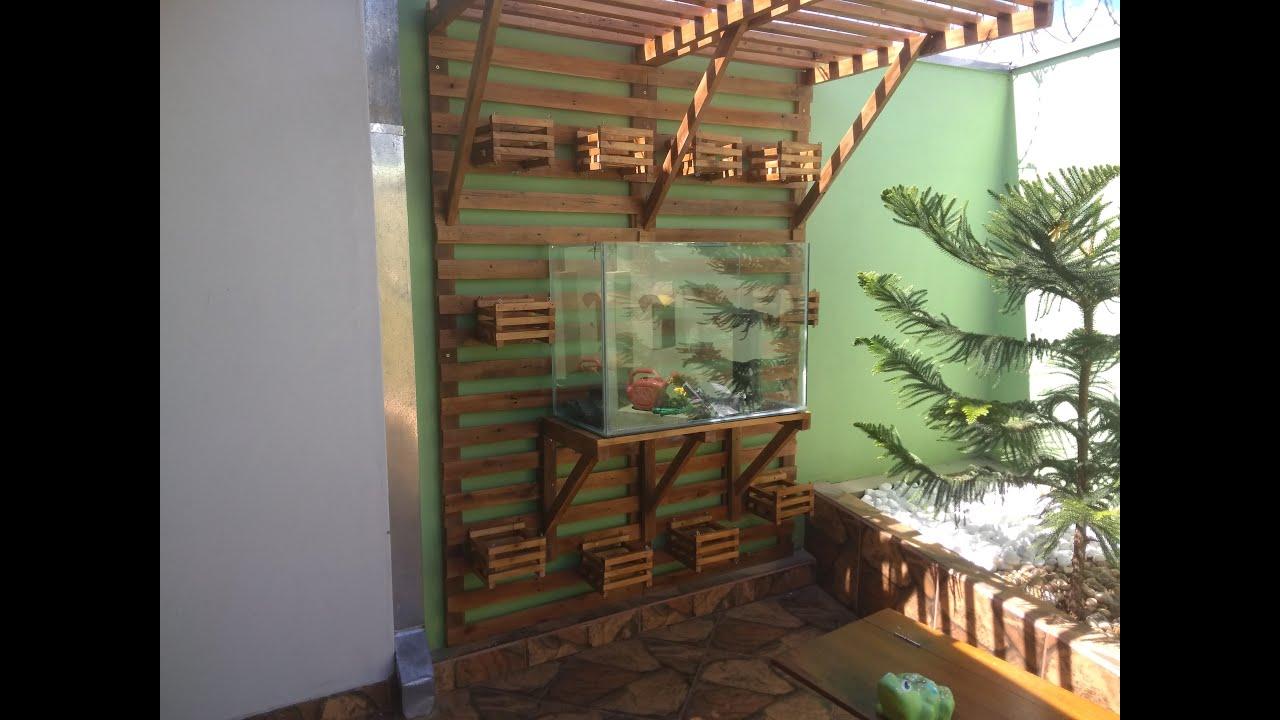 jardim vestical com aquario feito de paletes